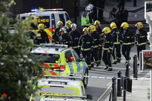 Members of the emergency services work near Parsons Green tube station in London, Britain September 15, 2017. REUTERS/Kevin Coombs