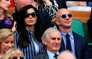 Jeff Bezos and Lauren Sanchez on day thirteen of the Wimbledon Championships at the All England Lawn Tennis and Croquet Club, Wimbledon. Sunday July 14, 2019. Mike Egerton/PA Wire.
