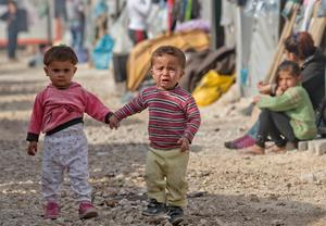 Syrian Kurdish refugee children from the Kobani area, hold hands at a camp in Suruc, on the Turkey-Syria border. Kobani, also known as Ayn Arab, and its surrounding areas, has been under assault by extremists of the Islamic State group since mid-September and is being defended by Kurdish fighters (AP Photo/Vadim Ghirda)