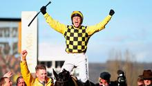 Jockey Paul Townend celebrates on Al Boum Photo after winning the Magners Cheltenham Gold Cup Chase during day four of the Cheltenham Festival. Photo credit: Simon Cooper/PA Wire.