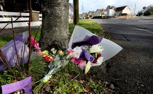 Flowers are left as a mark of respect for Jacqueline McGovern. Photo: Steve Humphreys