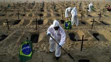 Activists of the NGO Rio de Paz in protective gear dig graves on Copacabana beach to symbolise the dead from the coronavirus disease (COVID-19) during a demonstration in Rio de Janeiro, Brazil. Photo: REUTERS/Pilar Olivares/File Photo