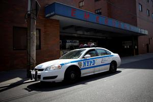 A NYPD car arrives at the Jamaica Hospital, where New York City plainclothes police officer Brian Moore who was shot in the head is being treated, in New York May 3, 2015. REUTERS/Eduardo Munoz