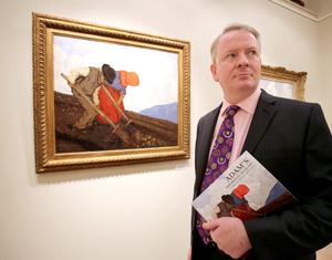 David Britton Director of Adam's, stands next to the Potato Diggers by Paul Henry. Photo: PA