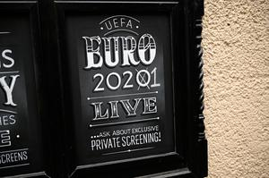 WAITING GAME: A sign advertising the now postponed Euro 2020 outside a closed-down pub in York, England. Photo: AFP via Getty Images