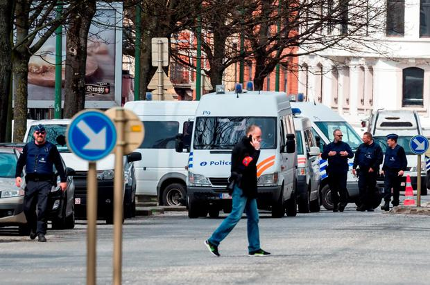 Police secure an area during a house search in the Etterbeek neighborhood in Brussels (AP Photo/Geert Vanden Wijngaert)