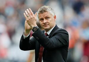 Manchester United manager Ole Gunnar Solskjaer applauds the fans after the match