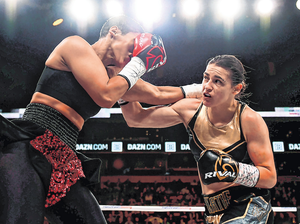 Katie Taylor lands a punch on Cindy Serrano during their lightweight world title bout in Boston in 2018. In May, Taylor will fight Serrano's sister Amanda in Manchester. Photo: Stephen McCarthy/Sportsfile
