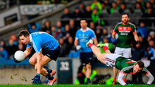 Dean Rock of Dublin breaks away from Colm Boyle of Mayo