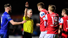 St Patrick's Athletic players remonstrate with referee Sean Grant back in February. Photo by Sam Barnes/Sportsfile
