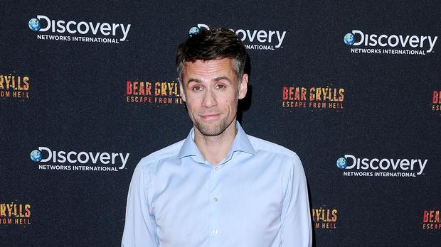 Richard Bacon is still in a medically induced coma but is improving (Ian West/PA)
