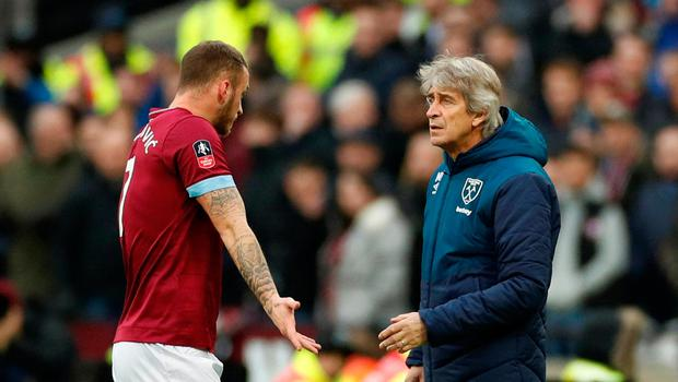 Soccer Football - FA Cup Third Round - West Ham United v Birmingham City - London Stadium, London, Britain - January 5, 2019  West Ham's Marko Arnautovic reacts as he is substituted off while West Ham manager Manuel Pellegrini looks on           Action Images via Reuters/John Sibley