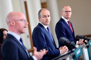 Concerns: Health Minister Stephen Donnelly and Taoiseach Micheál Martin expressed worries over crowded pub scenes. Photo: Julien Behal/PA Wire