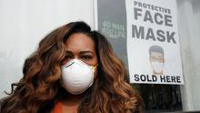 Masks: Adilisha Patrom poses outside her pop-up coronavirus supply store where she sells items such as face masks and hand sanitiser in Washington. Photo: REUTERS/Kevin Lamarque