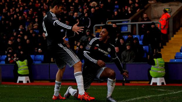 Chelsea's Willian (r) celebrates with Diego Costa after scoring his team's second goal against Crystal Palace. Photo: Getty Images