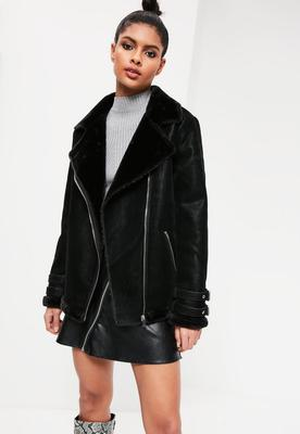Black oversized faux fur lined aviator jacket, €97.50 by Missguided