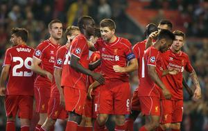 Liverpool's Steven Gerrard (C) celebrates with teammates after scoring a penalty against Ludogorets during their Champions League soccer match at Anfield