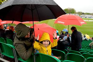 Tiernan O'Rourke, 4, and his father Kevin O'Rourke of Malahide stay dry together under their umbrella.