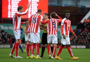 Stoke City players appeal to Referee Michael Oliver for a handball in the box