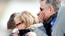 Relatives of the pilot of the Germanwings Airbus A320 pay their respects at the memorial for the victims of the air disaster in the village of Le Vernet