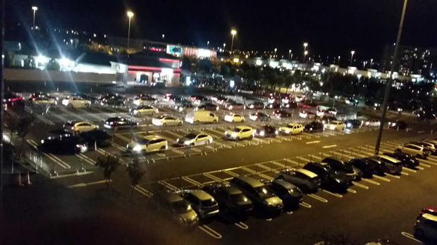Images sent by Independent.ie reader show cars lining up for doughnuts after dark.