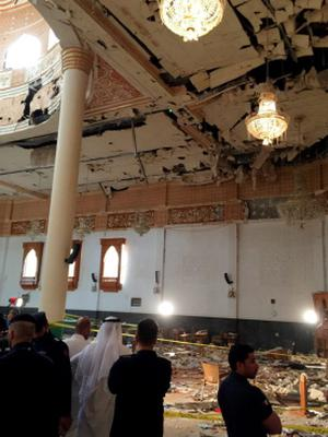 Police inspect the Imam Sadiq Mosque after a bomb explosion, in the Al Sawaber area of Kuwait City June 26, 2015. A suicide bomber blew himself up at the packed Shi'ite Muslim mosque in Kuwait city during Friday prayers, killing more than ten people, the governor of Kuwait City said. REUTERS/Kuwait News AgencyÄ®ATTENTION EDITORS - THIS IMAGE WAS PROVIDED BY A THIRD PARTY.  NO SALES. NO ARCHIVES.  THIS PICTURE IS DISTRIBUTED EXACTLY AS RECEIVED BY REUTERS, AS A SERVICE TO CLIENTS. FOR EDITORIAL USE ONLY. NOT FOR SALE FOR MARKETING OR ADVERTISING CAMPAIGNS       TPX IMAGES OF THE DAY