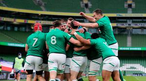 Ireland players celebrate after Keith Earls scores their first try of the match