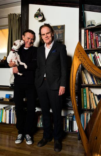 Frank Cassidy holds Finn, the brother's dog, while Patrick Cassidy stands next to him. Photo: Dylan Townsend