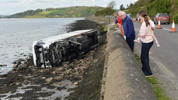 Scene on the Youghal to Dungarvan road where an articulated truck crash through a sea wall onto the forshore. Photo: Michael Mac Sweeney/Provision