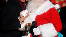 U.S. President Barack Obama (L) greets a man dressed as Santa Claus during the 92nd annual National Christmas Tree Lighting on the Ellipse near the White House in Washington December 4, 2014. REUTERS/Yuri Gripas