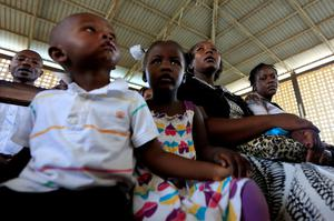 People attend the Easter Sunday service at the Catholic Church in Garissa April 5, 2015. REUTERS/Noor Khamis