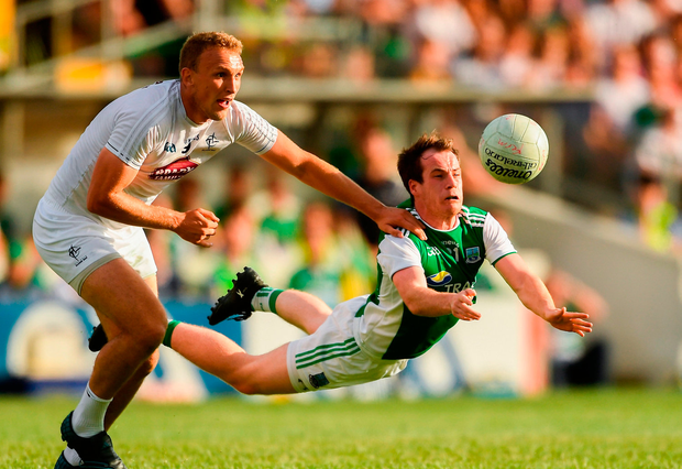 Ruairí Corrigan of Fermanagh in action against Tommy Moolick of Kildare
