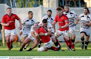 Paul OConnell is tackled by Andries Van Schalkwyk and Davide Giazzon.