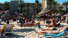 (FILES) - A file picture taken on October 31, 2013, shows tourists enjoying the beach near a four-star hotel in the resort town of Sousse, a popular tourist destination 140 kilometres (90 miles) south of the Tunisian capital. An attack on two tourist hotels in Sousse on June 26, 2015 killed several people, the interior ministry said. AFP PHOTO / BECHIR BETTAIEBBECHIR BETTAIEB/AFP/Getty Images