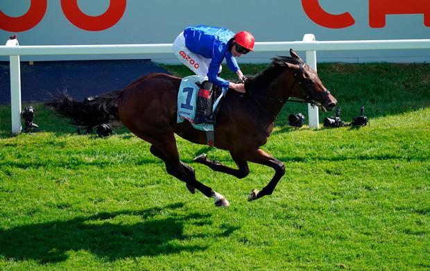Adayar ridden by jockey Adam Kirby on their way to winning the Cazoo Derby during day two of the Cazoo Derby Festival at Epsom Racecourse