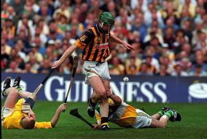 Kilkenny's Henry Shefflin shoots to score his side's goal despite the presence of Stephen Byrne, left and Kevin Martin, Offaly in the 2000 All Ireland Hurling Championship Final. Picture credit: Matt Browne/SPORTSFILE