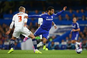 Chelsea winger Mohamed Salah evades a tackle from Bolton's Dean Moxey during their Captial One Cup game at Stamford Bridge. Photo: Richard Heathcote/Getty Images