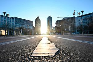 The sun is pictured on the background of the almost empty Potsdamer Platz square in Berlin on March 24, 2020, amidst the new coronavirus COVID-19 pandemic. (Photo: Getty Images)