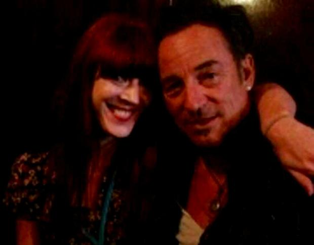 Bruce Springsteen with a fan in the pub in 2013