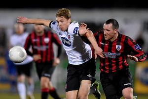David McMillan, Dundalk, in action against Pat Flynn, Longford Town