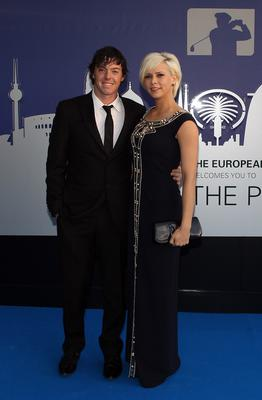 Rory McIlroy of Northern Ireland and Holly Sweeney arrive for the European Tour Players Awards Dinner at the Heathrow Sofitel Hotel on May 24, 2011 in London, England.  (Photo by Richard Heathcote/Getty Images)