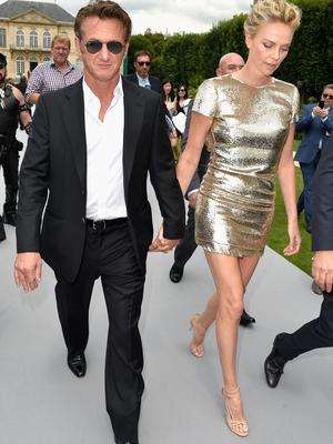 (L-R) Sean Penn and Charlize Theron attend the Christian Dior show