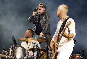 U2 performs a concert at the Olympic stadium in Turin.