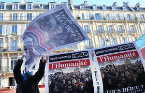 PARIS, FRANCE - JANUARY 11:  Posters are hung near to Place de la Republique prior to a mass unity rally to be held in Paris following the recent terrorist attacks on January 11, 2015 in Paris, France. An estimated one million people are expected to converge in central Paris for the Unity March joining in solidarity with the 17 victims of this week's terrorist attacks in the country. French President Francois Hollande will lead the march and will be joined by world leaders in a sign of unity. The terrorist atrocities started on Wednesday with the attack on the French satirical magazine Charlie Hebdo, killing 12, and ended on Friday with sieges at a printing company in Dammartin en Goele and a Kosher supermarket in Paris with four hostages and three suspects being killed. A fourth suspect, Hayat Boumeddiene, 26, escaped and is wanted in connection with the murder of a policewoman.  (Photo by Dan Kitwood/Getty Images)