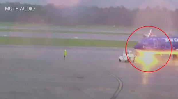 Terrifying moment an airport worker was electrocuted after lightning strikes plane