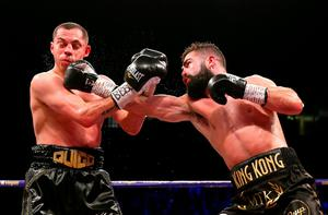 Jono Carroll punches Scott Quigg during their Super-Featherweight fight at Manchester Arena. (Photo by Alex Livesey/Getty Images)