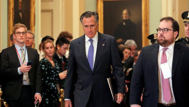Controversial: US Senator Mitt Romney walks from the Senate chamber during a break in the impeachment trial. Photo: REUTERS
