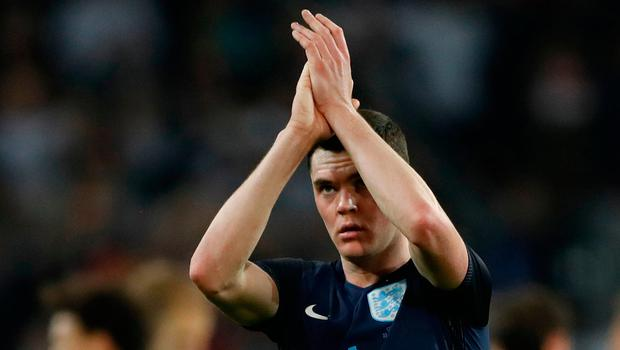 England's Michael Keane applauds fans after the match