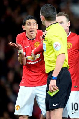Manchester United's Angel Di Maria (left) protests to referee Michael Oliver before being sent off during the FA Cup, Sixth Round match at Old Trafford
