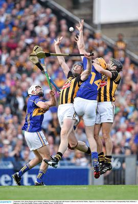 7 September 2014; Brian Hogan and JJ Delaney, Kilkenny, contest a high ball with Seamus Callanan and Patrick Maher, Tipperary. GAA Hurling All Ireland Senior Championship Final, Kilkenny v Tipperary. Croke Park, Dublin. Picture credit: Brendan Moran / SPORTSFILE